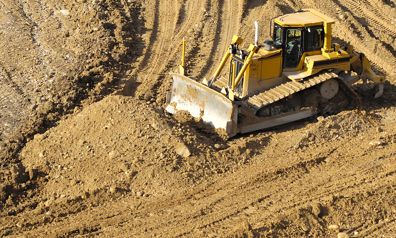 Bulldozer is working in a mine