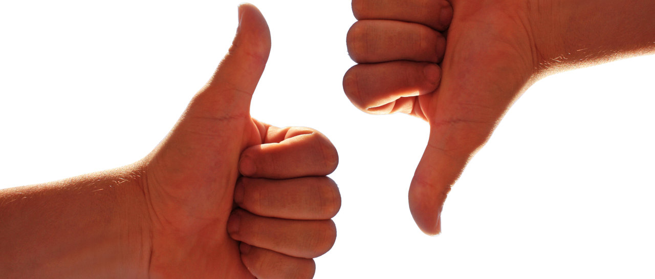 men's hands make thumbs up and down